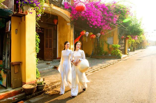 Die reine Schönheit der vietnamesischen Frauen mit dem nationalen Tracht in Fotos von Dzungart - ảnh 10