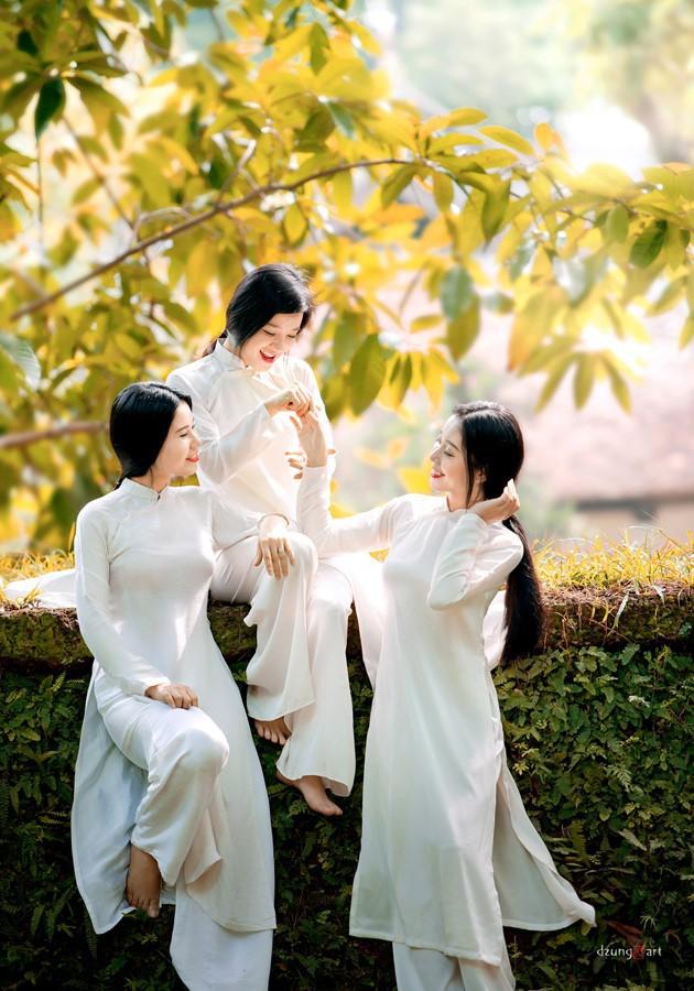 Die reine Schönheit der vietnamesischen Frauen mit dem nationalen Tracht in Fotos von Dzungart - ảnh 3
