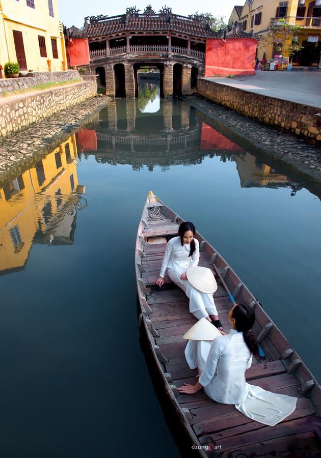 Die reine Schönheit der vietnamesischen Frauen mit dem nationalen Tracht in Fotos von Dzungart - ảnh 8