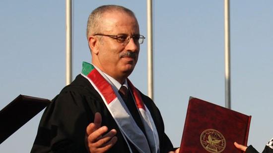 นายกรัฐมนตรีปาเลสไตน์คนใหม่ยื่นใบลาออกจากตำแหน่งต่อประธานาธิบดี มาห์มุด อับบาส   - ảnh 1
