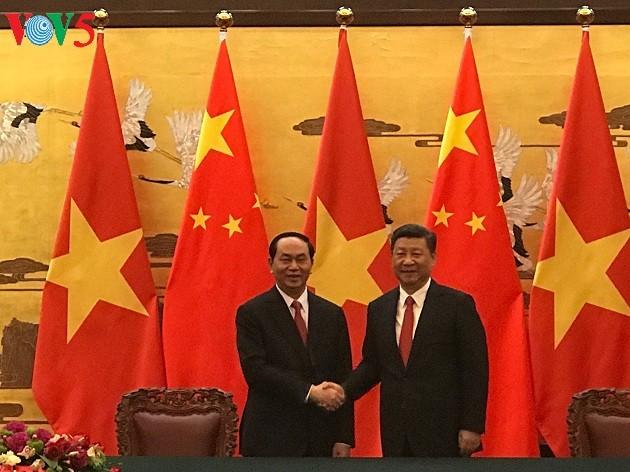 ประธานประเทศเวียดนามเจิ่นด่ายกวางเจรจากับประธานประเทศจีน สีจิ้นผิง - ảnh 1