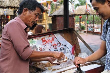 แม่ค้าหาบเร่ในเมืองเก่าฮอยอัน (ตอนที่ 3) - ảnh 1