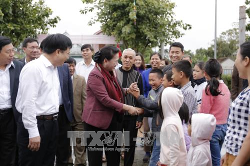 ประธานสภาแห่งชาติเหงวียนถิกิมเงินเข้าร่วมงานวันมหาสามัคคีชนในชาติ ณ ตำบลกิมเลียน จังหวัดเหงะอาน - ảnh 1