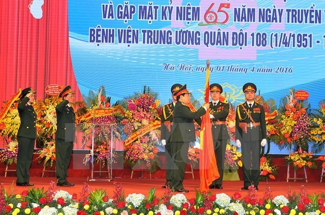 Military hospital gets credit for 65-year contribution - ảnh 1