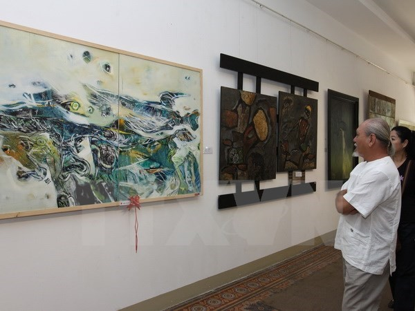 Traditional Vietnamese lacquer painting show in Hanoi - ảnh 1