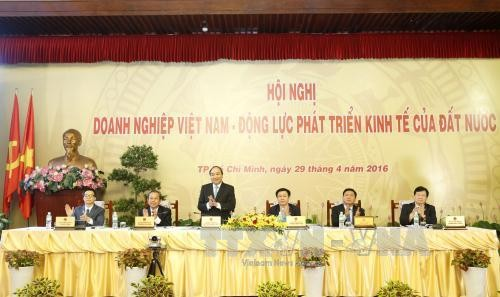 The government always supports businesses for national progress - ảnh 1