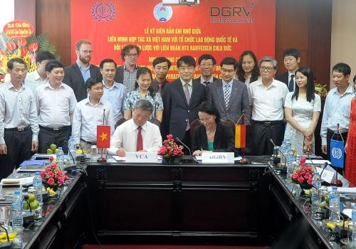 MoU signed between ILO and Vietnam Cooperative Alliance to raise cooperatives' capability  - ảnh 1