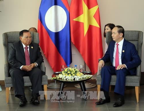 Tran Dai Quang rencontre Bounnhang Vorachith, Hun Sen et Moon Jae-in - ảnh 1