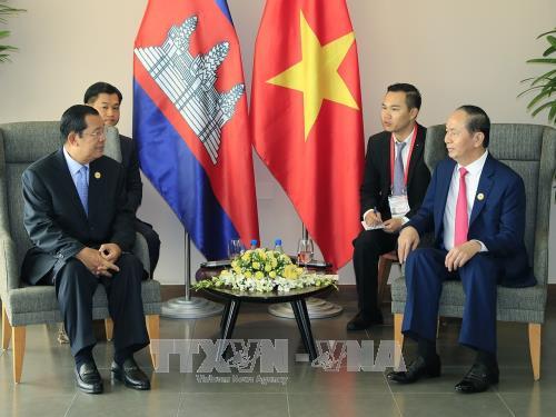 Tran Dai Quang rencontre Bounnhang Vorachith, Hun Sen et Moon Jae-in - ảnh 2