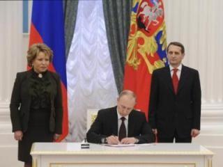 Presiden Rusia V.Putin memberlakukan Undang-Undang tentang penggabungan Krimea - ảnh 1