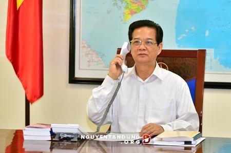 PM VN Nguyen Tan Dung melakukan pembicaraan via telepon dengan PM Australia, Tony Abbott - ảnh 1