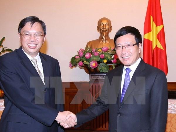 Vietnam dan Singapura memperkuat persatuan, mengembangkan peranan sentral dari ASEAN - ảnh 1