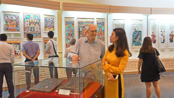 Twelve typical Vietnamese folk paintings exhibit in Ha noi - ảnh 3