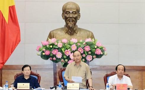 Primer ministro de Vietnam orienta el enfrentamiento al cambio climático en el delta del río Mekong  - ảnh 1