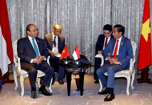 Primer ministro vietnamita se reúne con altos dirigentes de países participantes en 34 Cumbre de la Asean - ảnh 3