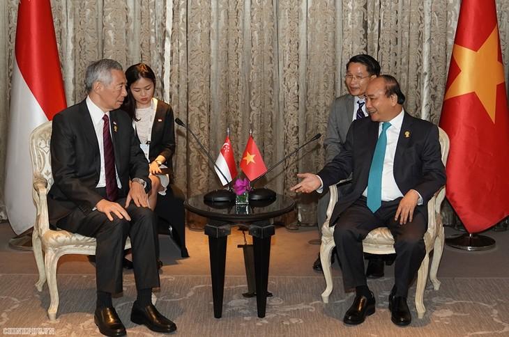 Primer ministro vietnamita se reúne con altos dirigentes de países participantes en 34 Cumbre de la Asean - ảnh 1