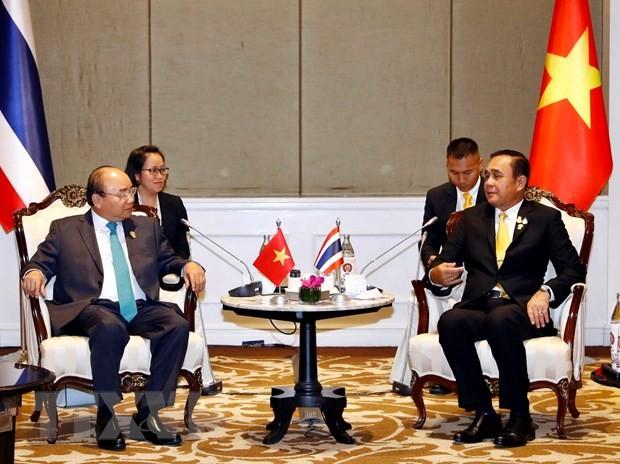 Primer ministro vietnamita se reúne con altos dirigentes de países participantes en 34 Cumbre de la Asean - ảnh 2
