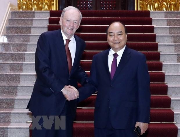 Primer ministro de Vietnam se reúne con expremier canadiense - ảnh 1