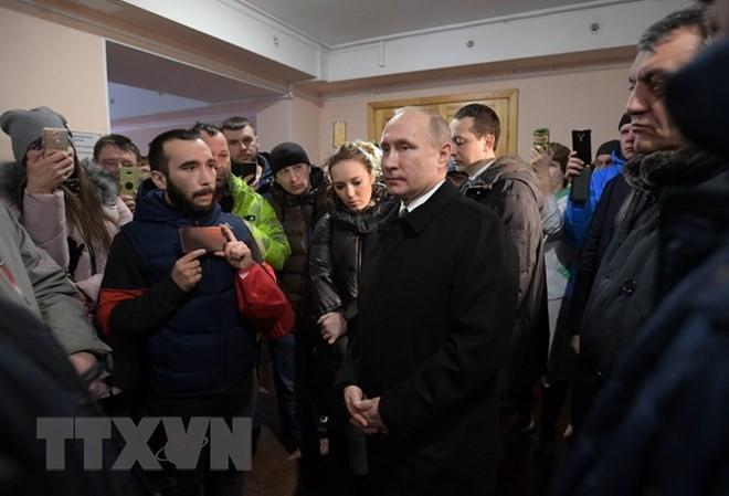 普京宣布28日为全国哀悼日 悼念克麦罗沃火灾遇难者 - ảnh 1