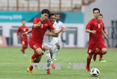 2018年亚运会:越南男足首战大胜 - ảnh 1