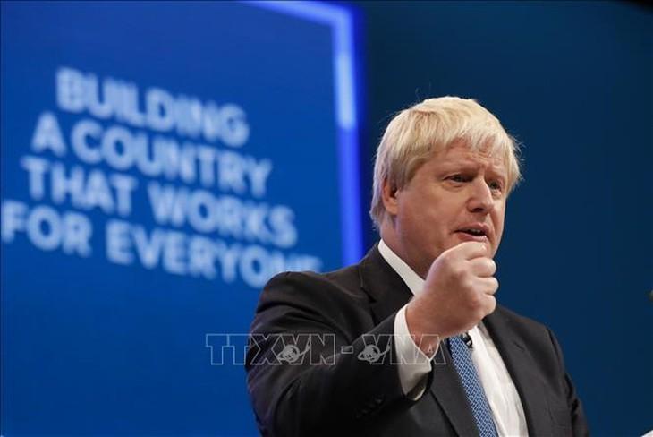 英国新任首相揭晓前夕 英国多名政府官员辞职 - ảnh 1