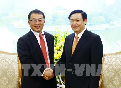 Vuong Dinh Hue salue la décision de Kirin d'augmenter ses investissements au Vietnam - ảnh 1