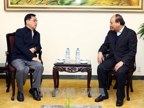Nguyen Xuan Phuc reçoit l'ancien Premier ministre laotien - ảnh 1