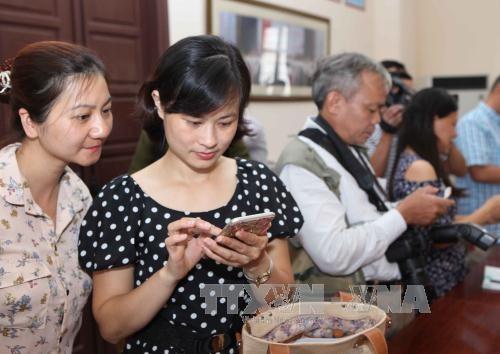 Près de 21.500 textos de soutien aux victimes des crues  - ảnh 1