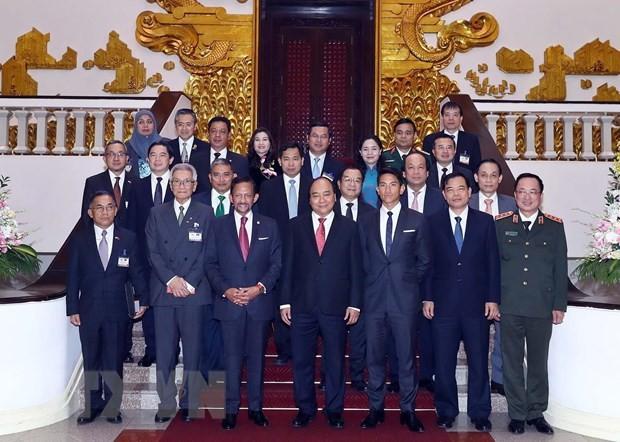 Le sultan de Bruneï achève sa visite officielle au Vietnam - ảnh 1