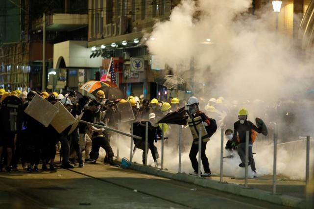 Chine: Pékin dénonce des actes «intolérables» après des dégradations à Hong Kong - ảnh 1