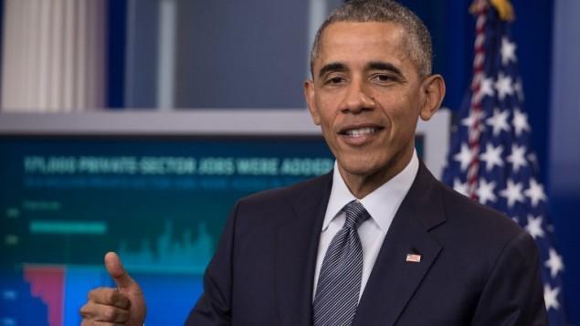 2016 US presidential race: Barack Obama calls for Donald Trump's record examination - ảnh 1
