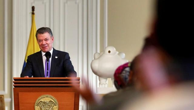 Colombia's President dedicates Nobel Peace Prize to conflict victims  - ảnh 1