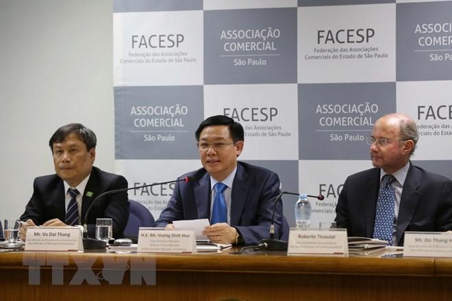 Vize-Premierminister Vuong Dinh Hue besucht Brasilien  - ảnh 1