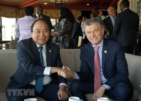 Премьер Вьетнама встретился с лидерами стран-участниц саммита G7 - ảnh 3