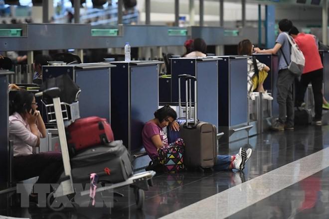 Аэропорт Гонконга возобновил воздушное сообщение - ảnh 1