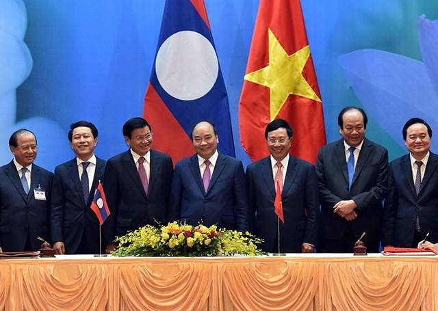 สร้างพลังขับเคลื่อนใหม่เพื่อทำให้ความร่วมมือระหว่างเวียดนาม - ลาวมีประสิทธิภาพและเป็นรูปธรรมมากขึ้น - ảnh 1