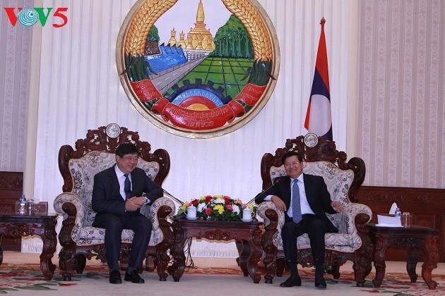 PM Laos memberikan penilaian tinggi terhadap dukungan dan bantuan VOV - ảnh 1