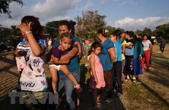 Masalah migran: AS bertekad mempertahankan kebijakan garis perbatasan keras - ảnh 1