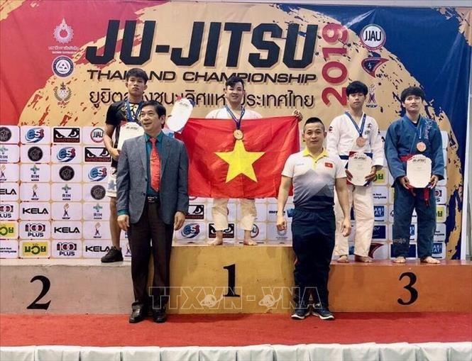 Vietnam berhasil menggondol medali emas di turnamen Ju-Jitsu Thailand terbuka - ảnh 1