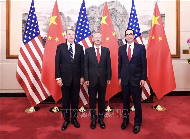 AS dan Tiongkok memulai putaran perundingan dagang yang baru di Beijing - ảnh 1