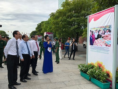 Photos recalling 70 years of patriotic movements on display - ảnh 1