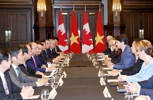 PM Viet Nam, Nguyen Xuan Phuc mengakhiri kehadiran di KTT G7 yang diperluas dan kunjungan-nya di Kanada - ảnh 2