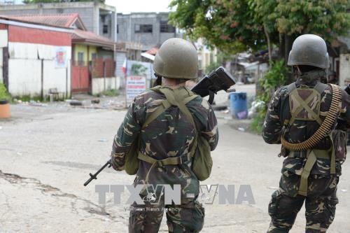Tentara Filipina  berbaku tembak dengan sisa-sisa pasukan IS - ảnh 1