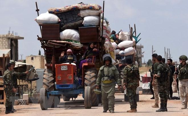 Suriah: Kira-kira 300 kaum pembangkan datang kawasan mengurangi ketegangan - ảnh 1