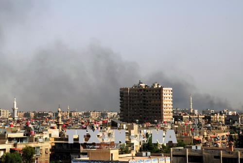 Irak melakukan serangan udara membasmi IS di Suriah - ảnh 1