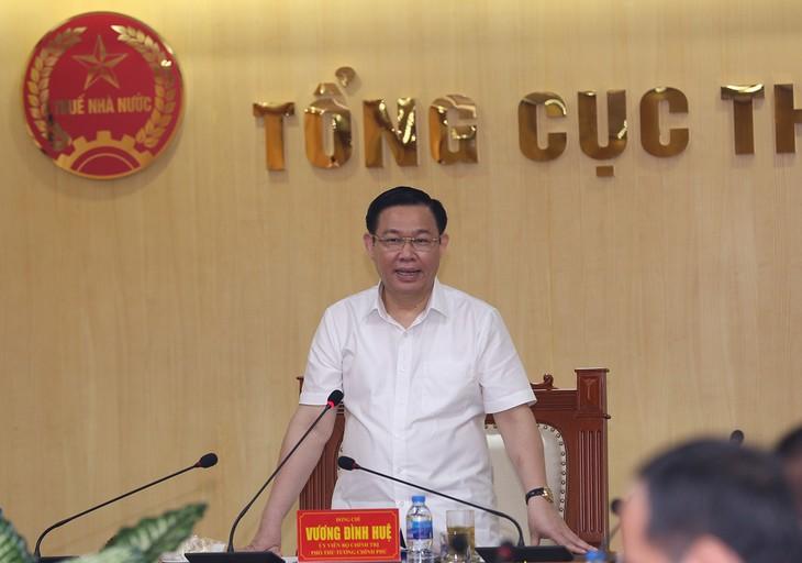 Deputi PM Vietnam, Vuong Dinh Hue melakukan temu kerja dengan Direktorat Perpajakan tentang RUU tentang Pengelolaan Pajak amandemen - ảnh 1