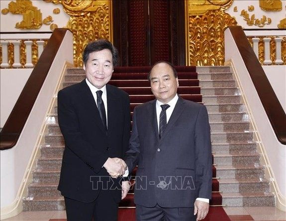 PM Nguyen Xuan Phuc dan Penjabat Presiden Vietnam, Dang Thi Ngoc Thinh menerima PM Republik Korea, Lee Nak-Yeon - ảnh 1