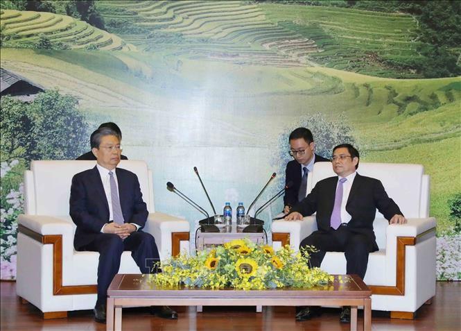 Kepala Departemen Organisasi KS PKV, Pham Minh Chinh menerima Sekretaris Komite Pemeriksaan Disiplin KS PKT, Zhao Leji - ảnh 1
