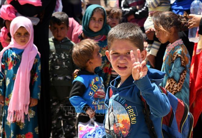 Menandatangani permufakatan tentang pelindungan anak-anak dalam bentrokan di Suriah - ảnh 1