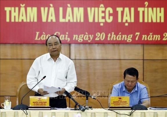 PM Nguyen Xuan Phuc melakukan temu kerja dengan Pimpinan Provinsi Lao Cai - ảnh 1